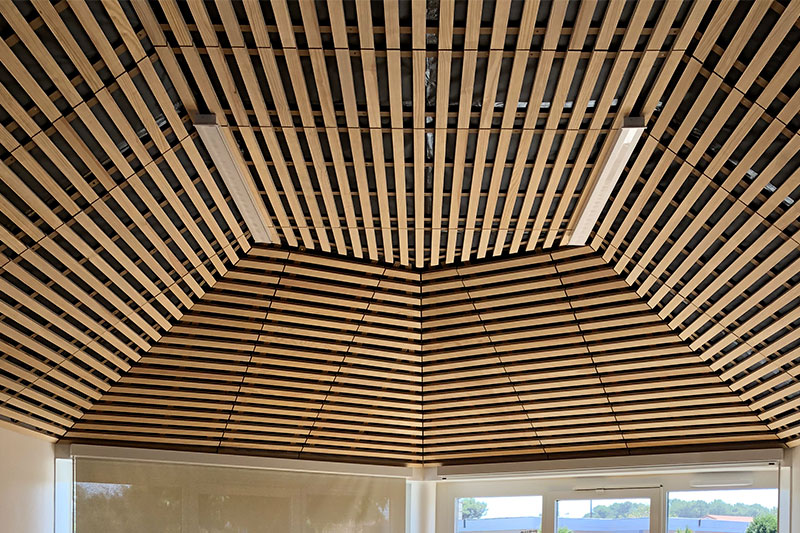 Ceiling Of Particular Shape Made From Wooden Crossbeams At The School Of The Beach In Biscarrosse By The Agency Bulle Architectes.