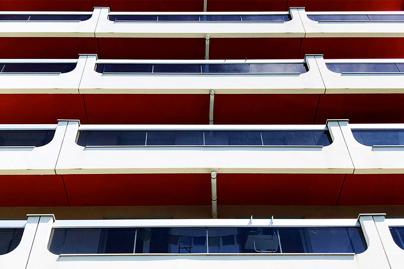 View Of The Balconies With Red Undersides Of The Residence Les Ecus Located In Bouscat And Rehabilitated By The Agency Bulle Architectes.