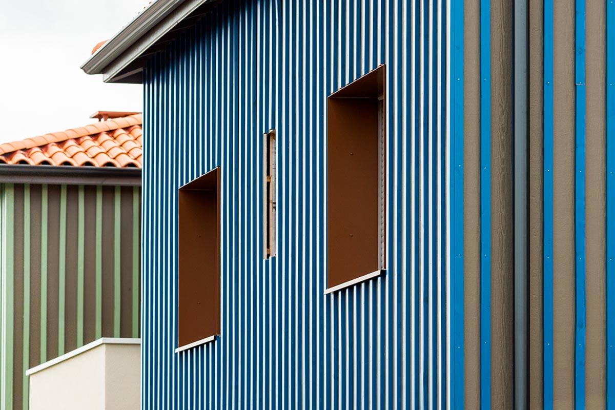 Zoom On A Facade With Blue Wooden Cladding Of The Residence L'Orée Du Parc Realized By The Agency Bulle Architectes At Teich.