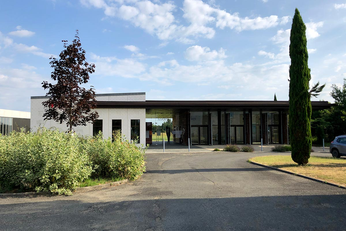 View On The Far Side From The Parking Lot Of The Town Hall Of Montpouillan Realized By The Agency Bulle Architectes.