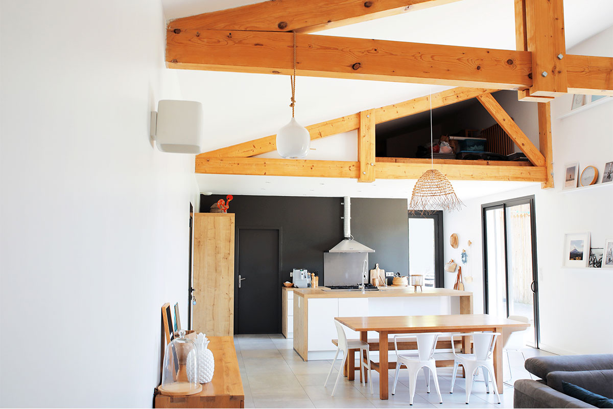 Overall View Of The Living/kitchen Area, Bright With Exposed Wooden Frame Of A Detached House Realized By Bulle Architectes In Biscarrosse.