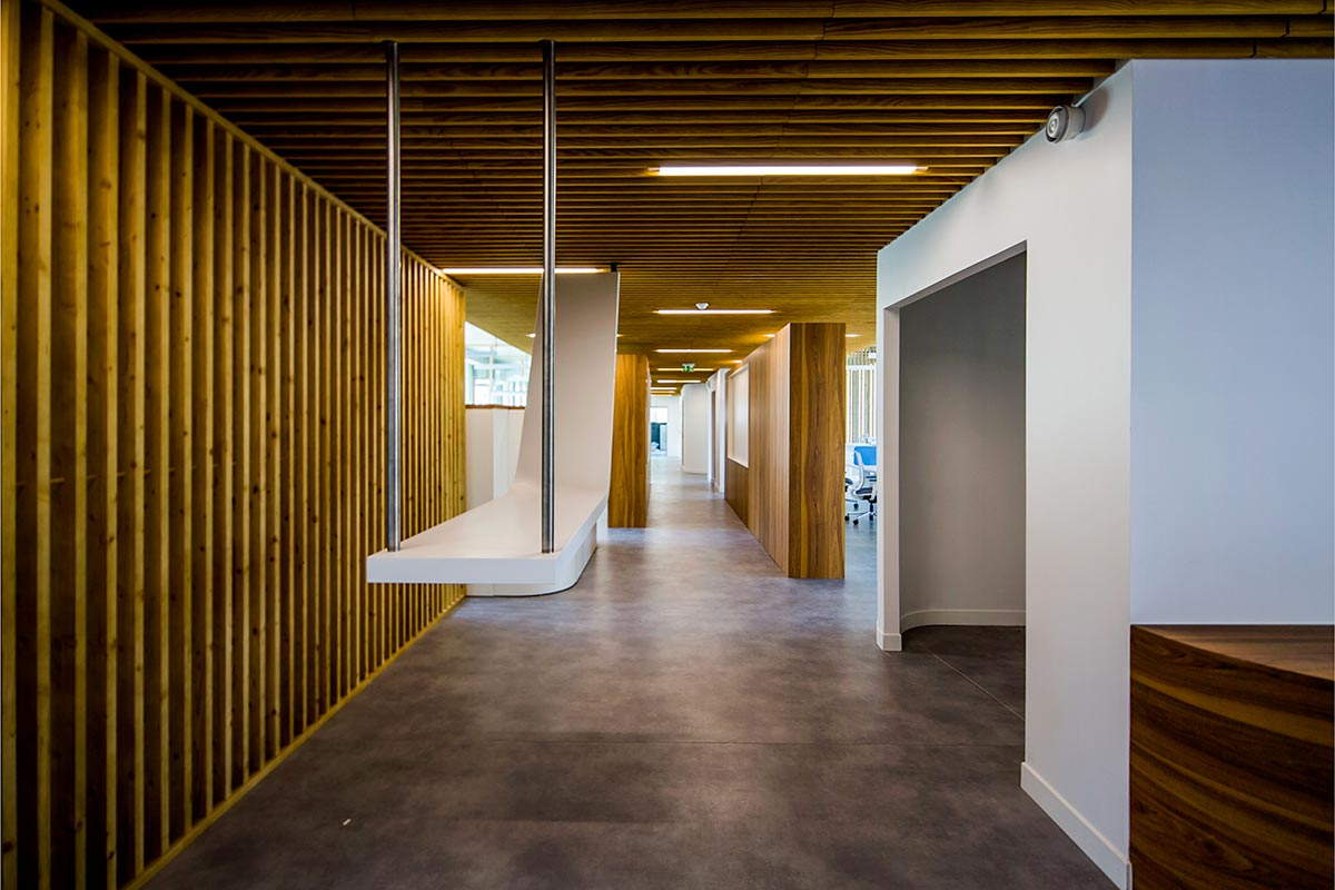 Interior Corridor Of The SIBA In Biganos With A Suspended Counter Realized By The Agency Bulle Architectes.